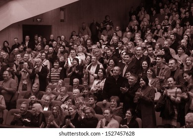 ODESSA, UKRAINE - October 9, 2019: Spectators in the theater. Spectators standing ovation favorite artists at the premiere of the play.
