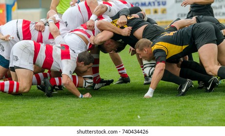 ODESSA, UKRAINE - Okt 20, 2017: Rugby Championship national team of Odessa - Kharkov. Intense struggle of players in rugby for ball. Dynamic game on green field of stadium