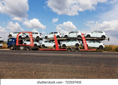 ODESSA, UKRAINE September 1, 2017: Car transporters carry cars. Transportation of car by specialized trucks. Special trailer for multi-tiered transportation of cars. Trailer transports cars