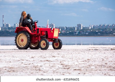 ODESSA, UKRAINE - september 13, 2015: the lord of powers of darkness Darth Vader and chewbacca go astride a wheel tractor on a bog at the river.