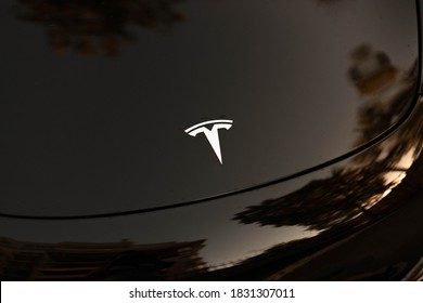 Odessa, Ukraine, September 13, 2020: Close up Tesla Motors logo on black electric car