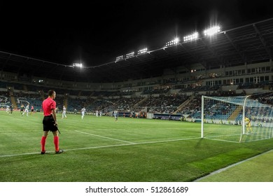 ODESSA, UKRAINE - September 15, 2016: Work linesman, the referee at the international football match of the Europa League. Side referees on the pitch in the dark and the floodlights