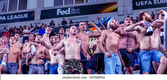 ODESSA, UKRAINE - September 15,2016: Active fans FENERBAHCE Istanbul - Zarya Lugansk in stands with attributes during match of Championship European Football League. Emotions stands of sports audience