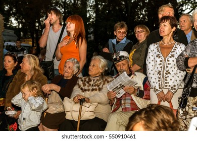 ODESSA, UKRAINE - September 21, 2014: Spectators at outdoor jazz concert in a city park. The audience, viewer watching a jazz festival in summer city park