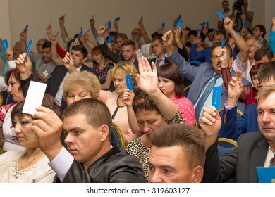 "Odessa, Ukraine - September 21, 2015: Start of elections in Ukraine. The party conference of the ""Renaissance."" Voting. People in the audience. Spectators. Assembly candidates."