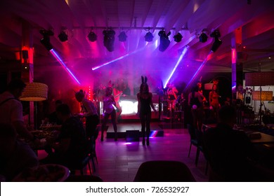 Odessa, Ukraine September 22, 2017: Official men's magazine Playboy night party. Beautiful girls entertain guests, beauty pageant, dancing and light show. The audience actively rest at party