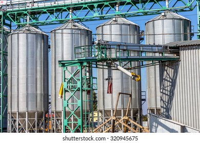 Odessa, Ukraine - September 26, 2015: Modern granary. Storage bins wheat and drying. Tanks for the storage of grain and metal girders of the auxiliary industrial equipment