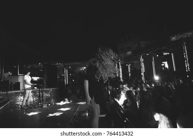 Odessa, Ukraine September 3, 2016: Itaka night club. Artist performs songs from stage during concert at nightclub. Artist on club stage during night party.