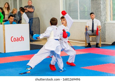 Odessa, Ukraine - September 30, 2019: Karate Championship among children of athletes. Best karate fighters children demonstrate their ability to fight on tatami. Battle of karate. Children's sports