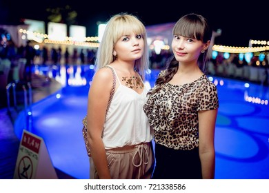 Odessa, Ukraine September 4, 2015: Ibiza night club. People smiling and posing on cam during concert in night club party. Man and woman have fun at club. Boy and girl at night club party