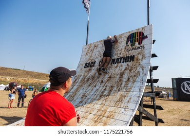 ODESSA, UKRAINE-August 19, 2018: Traditional Sports Races of Nation. Ukrainian race for survival in highlands of sea, overcoming dangerous obstacles, swimming and extreme trials on dangerous route