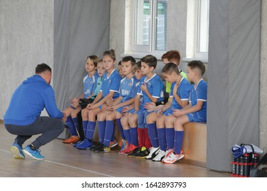 Odessa, Ukraine-December 12, 2019: Little boys, children play mini football in sports hall at sports city Junior championship. Children's sport is healthy lifestyle. Sports children football players