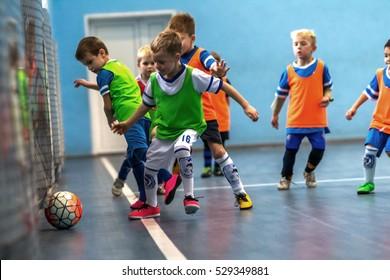 Odessa, Ukraine-December 3,2016: Little boys, children play in mini-football in indoor sports hall at Junior championship sports city. Children's sports - healthy lifestyle. Sport children footballers