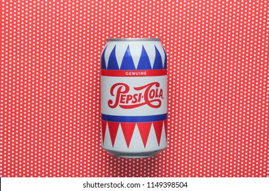 Odessa, Ukraine-July 30, 2018: Tin can Pepsi-Cola genuine on a red tablecloth in polka dot. Top view.