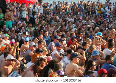 ODESSA-1 AUGUST,2017:Group of people partying at summer festival crowd on seaside party.Audience enjoy youth entertainment event on beach.European music festival on beach