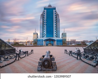 Odessa/Ukraine -03-27-2019: Monument of old gun with view to city skyscraper