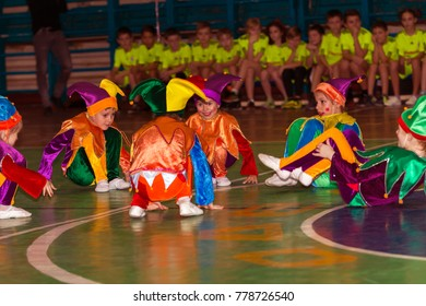 ODESSA,UKRAINE -December 16, 2017: Little clown children perform on an emotional show during children's sports competitions. Children perform in theater. Children music group sing and dance on stage