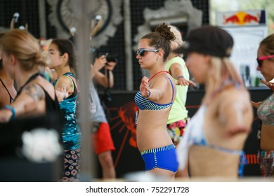 ODESSA,UKRAINE-21 AUGUST,2017:Female fitness festival.Summer sport and health event for young & sporty women.Pretty young girls practice fitness,stretching muscles