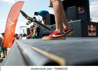 ODESSA,UKRAINE-21 AUGUST,2017:Nike SB skate shoes close up.Skater boy rides on skateboard in park.Skateboarding contest in summer.Extreme sports competition for young & active athletes