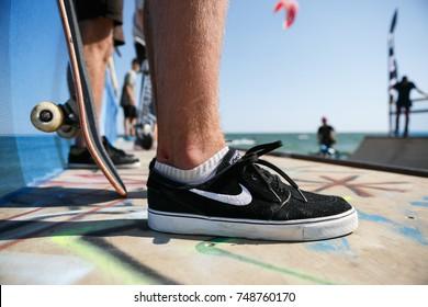 ODESSA,UKRAINE-21 AUGUST,2017:Skate boy feet wearing Nike SB sneakers
