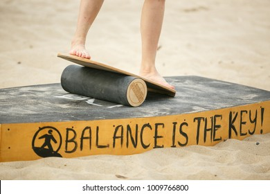 ODESSA,UKRAINE-25 AUGUST,2017:Balance board competition on the beach at summer youth festival Zgames.Feet of male athlete exercising on balancing boards