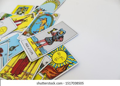 Odessa/Ukraine-September 10,2019:Tarot cards reading fortune telling predictiction of Rider Waite esoteric deck with page of cups sun arcana sign of luck on white background