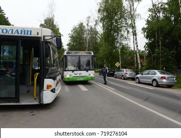 ODINTSOVO, RUSSIA - JUNE 20, 2015: Inspector of the road patrol service at the pedestrian crossing.