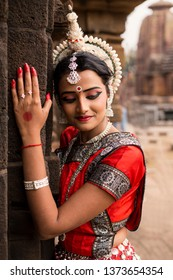 Odissi Dancer wears traditional costume posing at Temple, Bhubaneswar, Odisha, India
