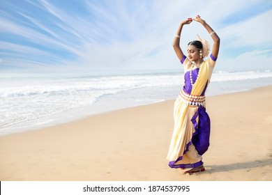 Odissi is a major ancient Indian classical dance form.Indian girl dancer in the posture in Front of the Bay of Bengal Sea Konark, Odisha