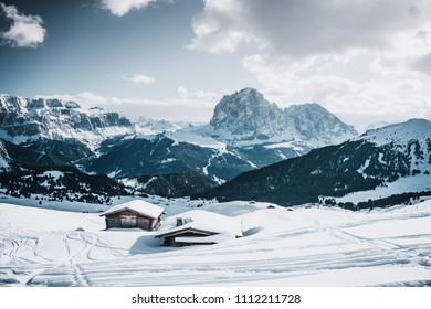 Odle mountain range, Seceda peak between clouds in winter , Val Gardena in Dolomites at Italy