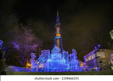 Odori Park, Sapporo, Hokkaido Japan - February 2018 : Snow sculpture in Sapporo Snow Festival with Sapporo TV tower background