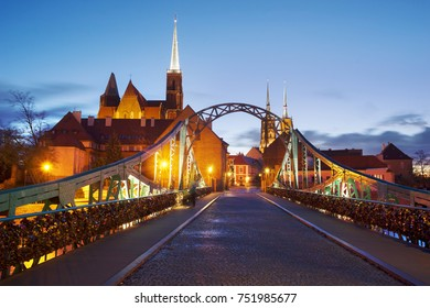 Odra River is a beautiful old city of Wroclaw with illumination of night Gothic Catholic temples on the Tumsky Island. The bridge is hung with locks as a symbol of love and fidelity