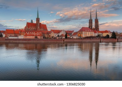 Odra river with Cathedral of St. John the Baptist and Collegiate Church of the Holy Cross and St. Bartholomew water reflections, Wroclaw