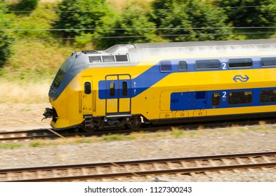 Oegstgeest, Netherlands, 04-07-2018: A NS train passing by on a summer day