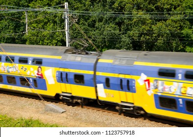 Oegstgeest, Netherlands, 28-06-2018: A Dutch train from the company NS passing by