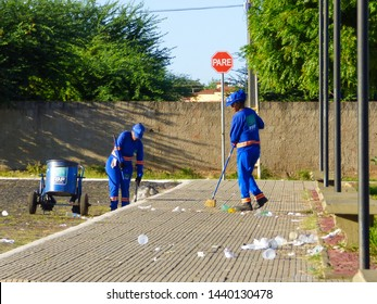 Oeiras, Brazil - Circa June 2019: Two women in uniform from the municipal garbage collection service cleaning the strees of Oeiras