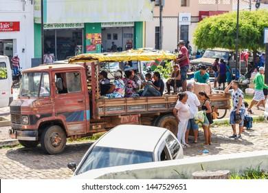 Oeiras, Brazil - Circa June 2019: Pau de arara - a flat bed truck adapted for passenger transportation, still very common in the Northeast Brazil