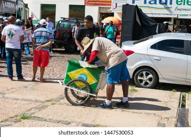 Oeiras, Brazil - Circa June 2019: Mobile ice cream vendor in the historic center of Oeiras