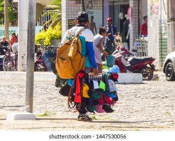 Oeiras, Brazil - Circa June 2019: Street hawker selling hats in the historic center of Oeiras