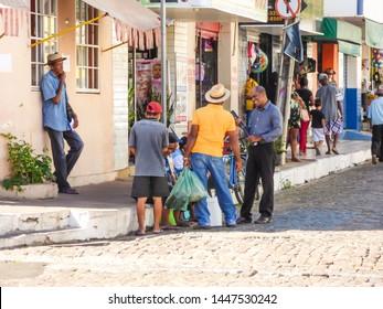 Oeiras, Brazil - Circa June 2019: Men chatting in the historic center of Oeiras