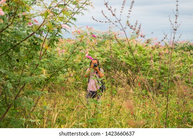Oeiras, Brazil - Circa May 2019: Man taking a picture among the Caatinga biome vegetation in the countryside of Oeiras - Piaui state