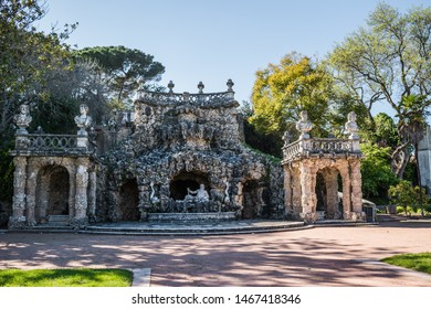 Oeiras, Lisboa PORTUGAL - 10 March 2019 - Poets Waterfall with God River figure in the center in the gardens of the Marquis of Pombal Palace