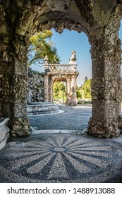 Oeiras, Lisboa PORTUGAL - 10 March 2019 - Marquês de Pombal Palace Garden, Stone arch tower perspective Renaissance-inspired Poets waterfall