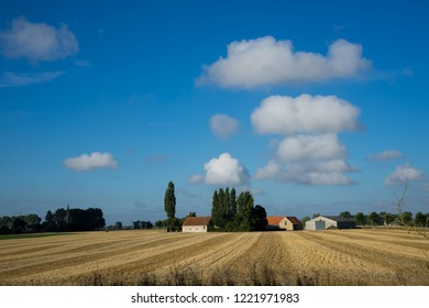 Oeren, Belgium - August 5, 2018: Farm in Westhoek West Flanders Belgium under big sky with clouds