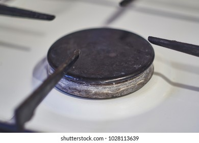 off gas burner without flame on white background on the stove in the kitchen.