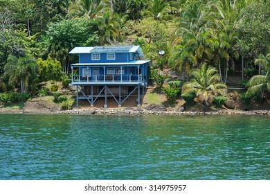 Off grid coastal home with lush tropical vegetation, Caribbean shore of Panama, Bocas del Toro, Central America