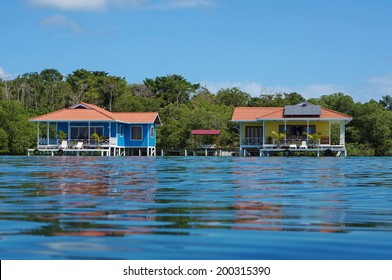 Off grid over water bungalows, one with solar panels, Caribbean sea, Panama