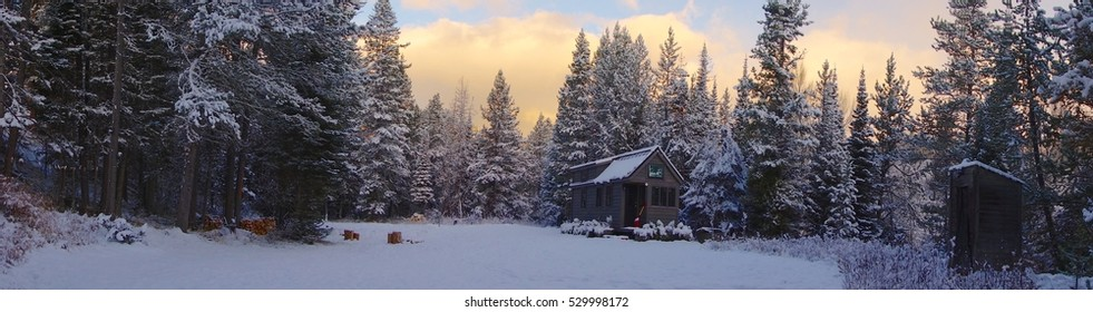 Off grid tiny House in the snowy woods.