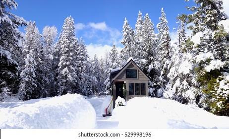 Off grid tiny house under deep snow.