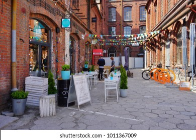 OFF PIOTRKOWSKA STREET , LODZ, POLAND, MAY 12  2017 :  Piotrkowska Street in Lodz, Main shopping street and representative, shopping and entertainment promenade